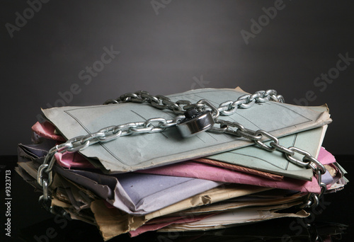 Stack of folders with chain and a padlock