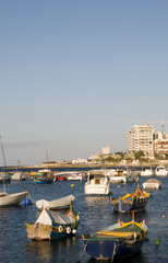 malta maltese luzzu boats in harbor overdevelopment