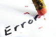 "closeup of a pencil erasing an ""error"""