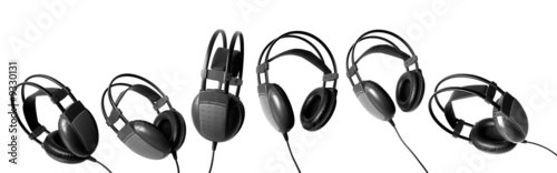 six big black headphones on a white background