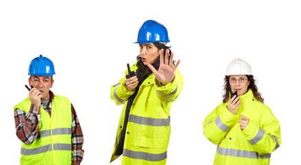 Construction workers over a white background. Focus at front