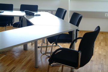 office room with table chairs and telefone