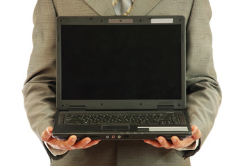 Computer on hands of the businessman