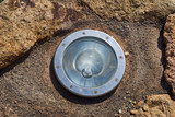 Built-in Lamp..Round light source built in on rock close-up poster