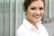 Businesswoman with bluetooth headset