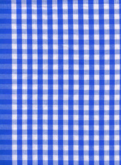 Background from a natural fabric in a blue and white cell