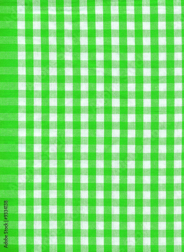 Background from a natural fabric in a green and white cell