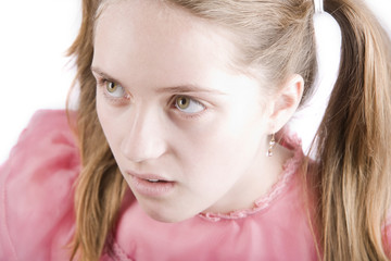 Bratty young girl with a disgusted expression on her face