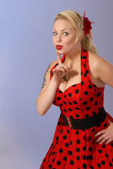 fifties style attractive pinup girl gestures - humorous