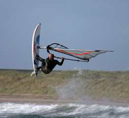 Windsurfers jumping the waves at Rhosneiger