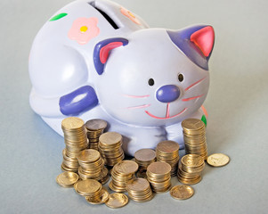blue cat - moneybox with columns of coins