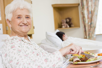 Young Woman Eating Hospital Food