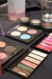A close up image of colorful makeup  palettes poster