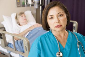 Doctor Looking Serious In Patients Room