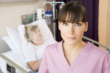 Nurse Standing In Patients Room