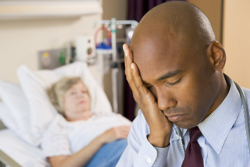 Doctor Looking Tired And Frustrated In Hospital Room
