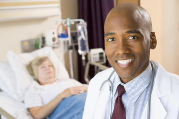 Doctor Smiling In Patients Room