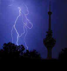 lightning and communication tower in stormy night
