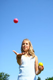 Young girl juggling poster