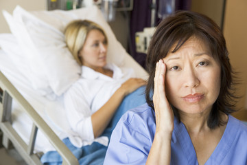 Doctor In Patients Room With Headache