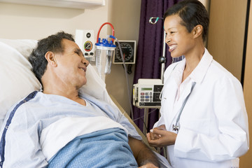 Doctor And Patient Talking To Each Other,Smiling