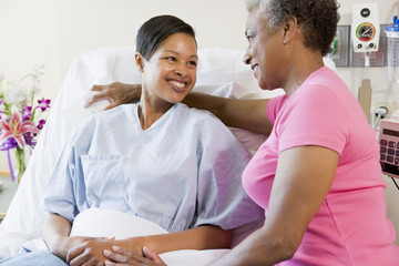Woman And Her Mother Talking In Hospital