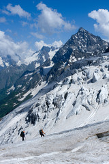 mountain climbers moving down on glacier