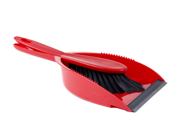 A bright red dust pan ready for your sping cleaning