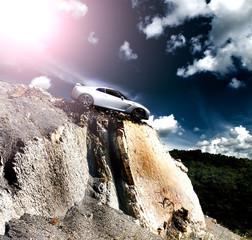 sports car on a rock