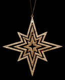golden glitter christmas star decoration on black background poster