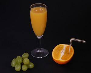 Fresh Orange Juice half and orange and some grapes