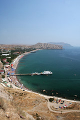 View at Sudak city and gulf with beach on Crimea Ukrain