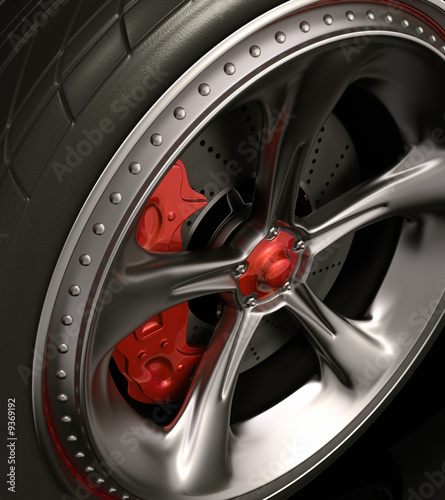 Close of chromed wheel with red details. Exclusive design.