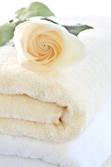Stack of soft luxury towels with fresh flower