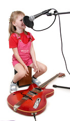 girl sing to studio microphone