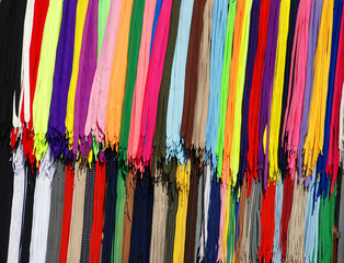 multicolored new laces hanging in row