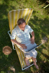 Healthy senior man is his elderly 70s sitting in garden