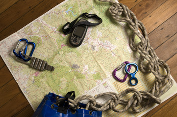 view of adventure gear including map and GPS