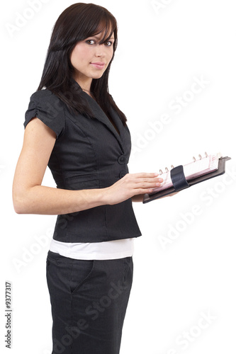Beautiful young brunette businesswoman wearing a black suit