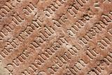 Vintage gothic script on a tomb. Cemetery in Salzburg, Austria. poster