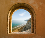 Fototapety arched window on the coastal landscape of a bay