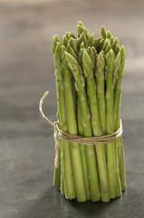 a bundle of raw little green asparagus