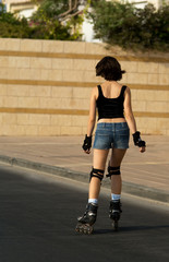 The young woman roller skating