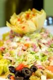 An image of a bountiful artichoke salad poster