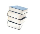 A pile of thick books isolated on white poster