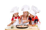 Kids with their mother preparing a pizza - isolated