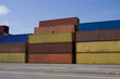 Stacks of colored cargo containers in a major port.