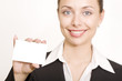 Beautiful business woman holding a blank card