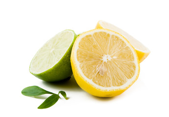 Lemons and Limes with leaves  on white