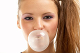 Portrait of the girl inflating a bubble of a chewing gum poster